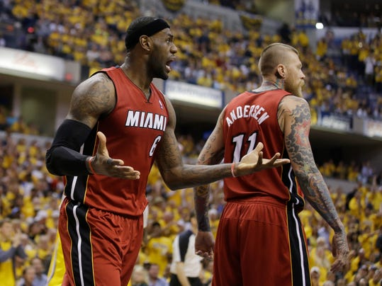 Miami Heat's LeBron James (6) reacts after his teammate Chris Andersen (11) was called for a foul during the second half of Game 1 of the Eastern Conference finals NBA basketball playoff series against the Indiana Pacers Sunday, May 18, 2014, in Indianapolis. Indiana defeated Miami 107-96. (AP Photo/Darron Cummings)