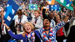 Hillary Clinton supporters from New York cheer during