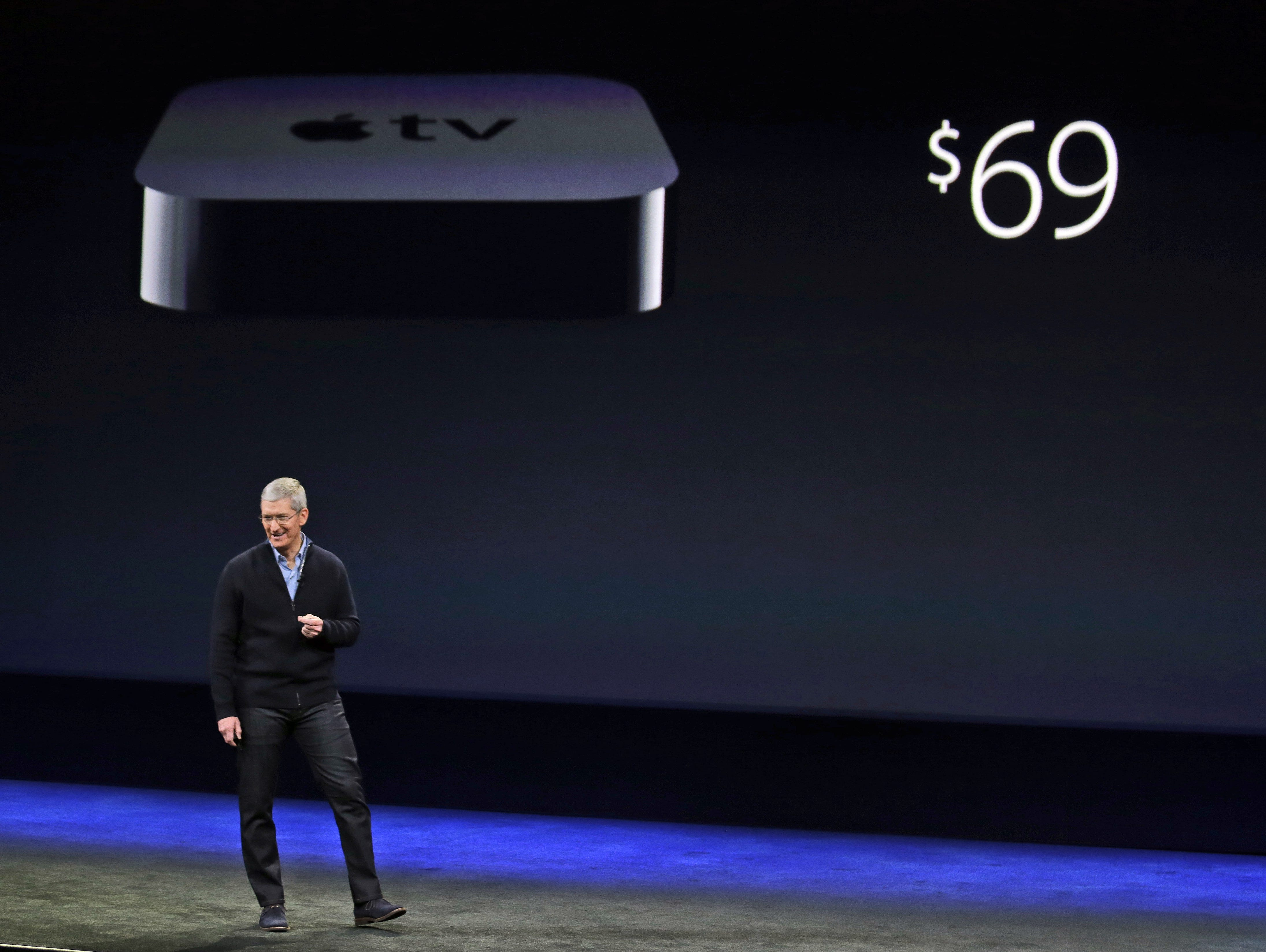 Apple CEO Tim Cook talks about Apple TV's new lower price during an Apple event on Monday, March 9, 2015, in San Francisco. WSJ says Apple now has no plans for a TV. (AP Photo/Eric Risberg) ORG XMIT: FX107