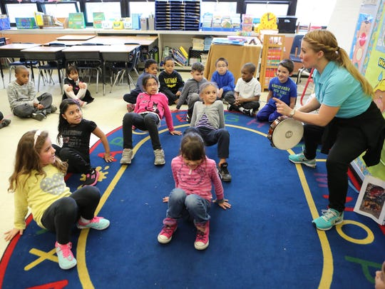 Dance instructor Kendra Mace, right, leads first graders in a lesson about sea life Wednesday in Joanne Riolo's class at School 22 in Yonkers.