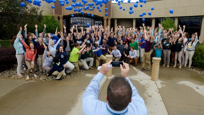 O'Gorman High School principal Kyle Groos snaps a photo as seniors release helium balloons to celebrate O'Gorman being named as one of 337 National Blue Ribbon Schools nationwide Tuesday by the U.S. Department of Education.