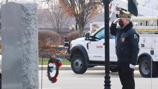 Steve Leonard of the VFW Color Guard salutes after placing a wreath at the World War I memorial in downtown Pontiac Wednesday. Wreaths and salutes were provided at each of the monuments in front of the historic Livingston County Courthouse in observance of Veterans Day.