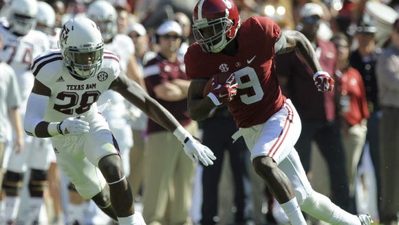 Alabama wide receiver Amari Cooper gets by Texas A&M