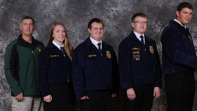 Marshfield FFA Chapter advisor Mark Zee, at left, is shown with the chapter members Zach Gilbertson, Charlotte Urban, Brad Weber and Luke Guldan.