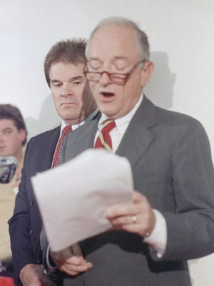 Former Cincinnati Reds manager Pete Rose listens as his lawyer Reuven Katz reads from a statement during a press conference at Riverfront Stadium Thursday, August 25, 1989, despite the lifetime suspension given him by baseball commissioner A. Bartlett Giamatti, Rose continues to claim he did not bet on baseball.