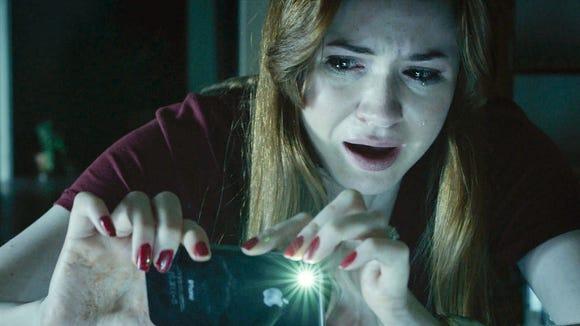 Karen Gillian looks terrified in a scene from 'Oculus.'