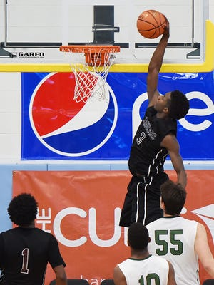 Appo's Myles Cale goes up for a dunk during early action of the Slam Dunk to The Beach on Sunday afternoon at Cape Henlopen High School. Appoquinimink fell to Maret School in four overtimes.