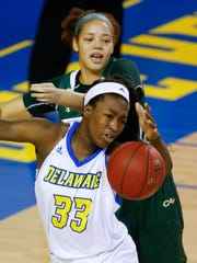 Delaware forward Nicole Enabosi (33) reaches for a rebound with William and Mary's Chandler Smith in the first half of Delaware's 67-63 win at the Bob Carpenter Center Tuesday.