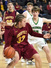 Roosevelt's #33 Chase Duffy drives to the basket against