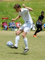 Jackson Christian's Bodo Wohlfromm gains control of the ball during the Class A-AA Soccer sectional against Dyersburg Saturday.