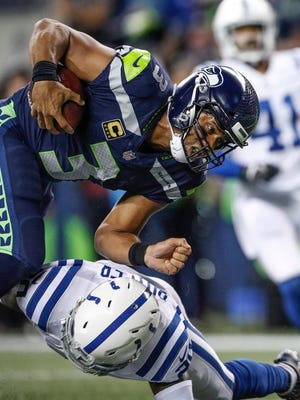 Seattle Seahawks quarterback Russell Wilson (3) runs in for a touchdown against the Indianapolis Colts at CenturyLink Field in Seattle on Sunday, Oct. 1, 2017.