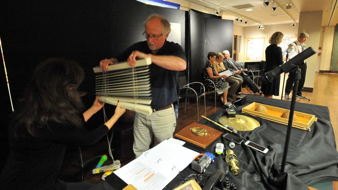 """Foley artists Cathie DeRolph, left, and Dean DeRolph perform sound effects for the Garret Players production of """"Vintage Hitchcock"""" Tuesday at the Fairfield County District Library in Lancaster. Performances of the radio-style show will be Nov. 7-9."""