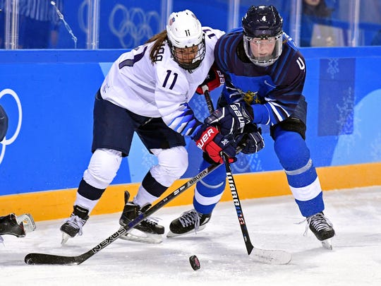 Feb 11, 2018; Gangneung, South Korea; United States forward Haley Skarupa (11) and Finland defenseman Rosa Lindstedt (4) go for the puck during women's hockey group A play during the Pyeongchang 2018 Olympic Winter Games at Kwandong Hockey Centre. Mandatory Credit: Andrew Nelles-USA TODAY Sports