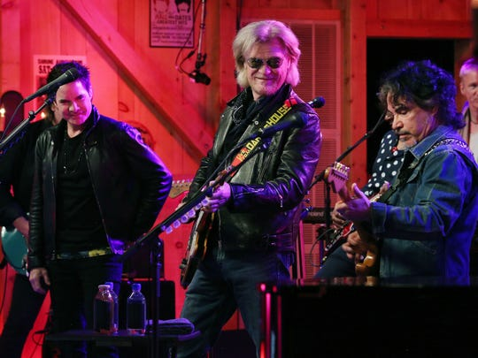 Pat Monahan from the band Train, left, performs with Daryl Hall, center, and John Oates of Hall and Oates at Daryl's House in Pawling Tuesday. The performance was attended by Live Nation contest winners and streamed live over Facebook and YouTube.