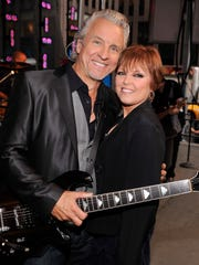 "Neil Giraldo and Pat Benatar pose before performing on ""FOX & Friends"" All American Concert Series at FOX Studios in 2012 in New York City."