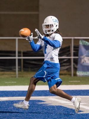 Antoine Griffin (7) catches a pass during football practice at the University of West Florida in Pensacola on Monday, December 11, 2017.