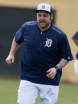 Detroit Tigers reliever Joba Chamberlain goes through warm-up drills Tuesday, Feb. 24, 2015, in Lakeland, Fla.