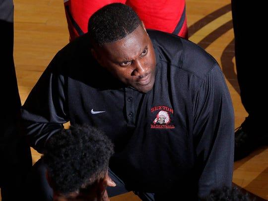 Sexton High School coach Carlton Valentine talks to