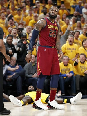 Cleveland Cavaliers forward LeBron James (23) reacts to fouling Indiana Pacers guard Lance Stephenson (1) during the second half of Game 6 at Bankers Life Fieldhouse on Friday, April 27, 2018.