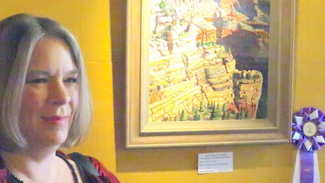 """Purchase Prize Show Judge Carole Andreen Harris with Timithy Gordon's Best of Show winning entry, an acrylic painting titled """"Early Morning From the South Rim."""""""