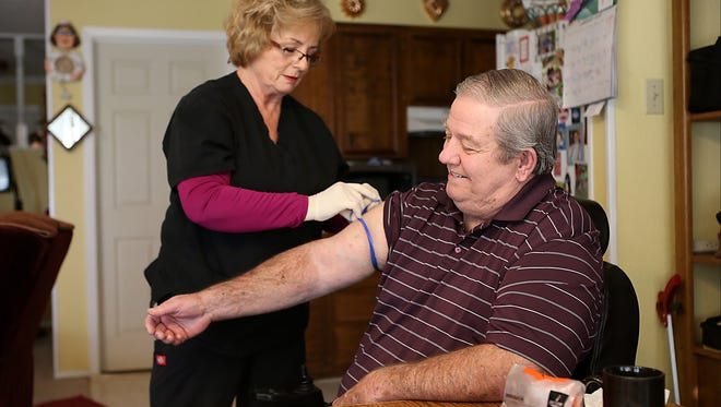 Veteran Jerry Smith jokes with Mary Ann Colvert, registered nurse with the West Texas VA Health Care System, as she prepares to draw blood during a home visit Wednesday, Jan. 24, 2018. The visit is part of the VA's Home Based Primary Care program.