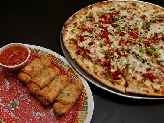 Pizza rolls left, and the Bacon popper pizza with thin, brown crust, right, served at Fong's, 223 Fourth St. in Des Moines.