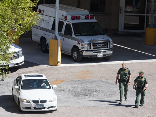 United States Customs and Border Protection agents on Wednesday, Oct. 25, 2017, walk out of Driscoll Children's Hospital where they detained an undocumented 10-year-old girl and were waiting to transfer her to a children's facility in San Antonio.