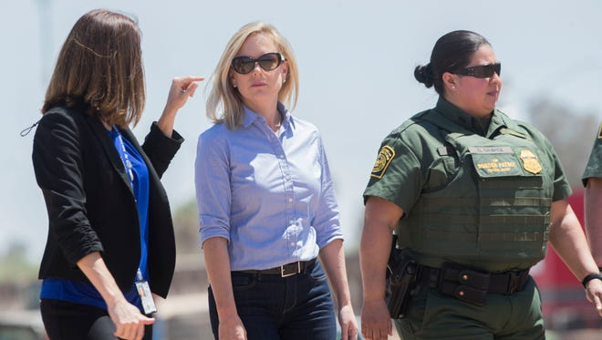 Department of Homeland Security Secretary Kirstjen Nielsen surveys the international border in Calexico, California on April 18, 2018.