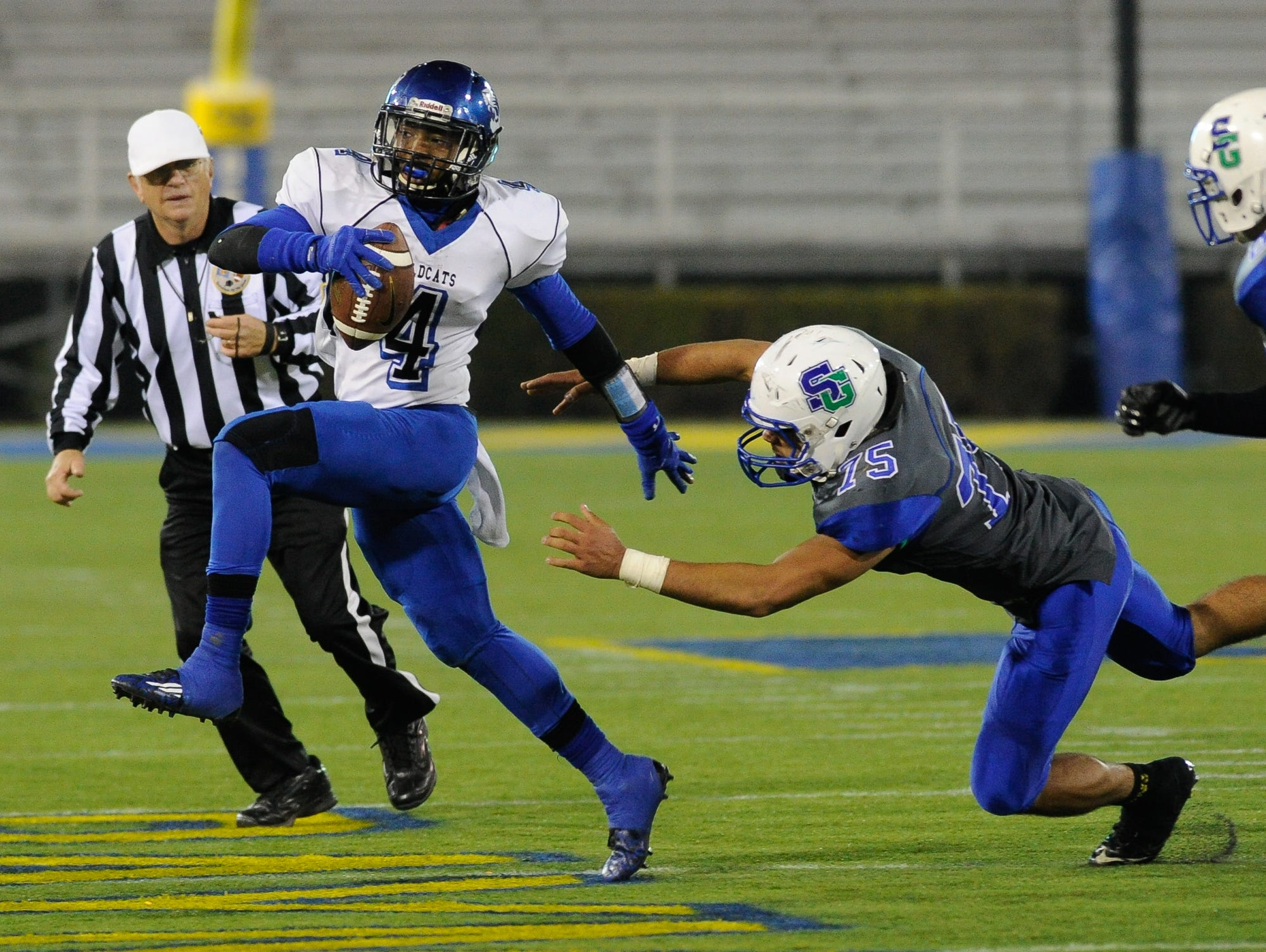 Howard's quarterback #4 Earnest Austin evades a tackler during the Division II championship against St. George's.