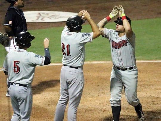 Nashville Sounds catcher Bruce Maxwell, right, celebrates a three-run home run against the El Paso Chihuahuas with teammates late in the game Saturday at Southwest University Park.