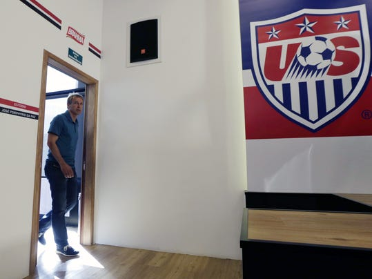 United States head coach Jurgen Klinsmann arrives to a press conference in Sao Paulo, Brazil, Wednesday, July 2, 2014. The U.S. was eliminated from the second round of the 2014 soccer World Cup in a 2-1 loss to Belgium in Salvador, Brazil. (AP Photo/Julio Cortez)