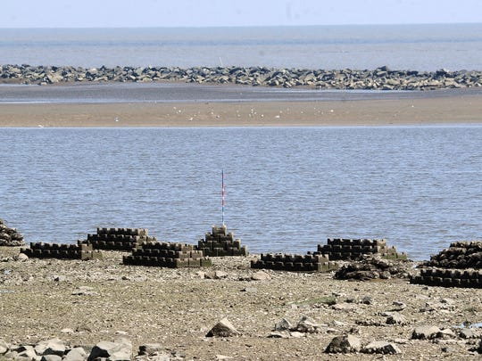 """Oyster Castles"" placed along the shore of the Mispillion River by Partnership for Delaware Estuary."