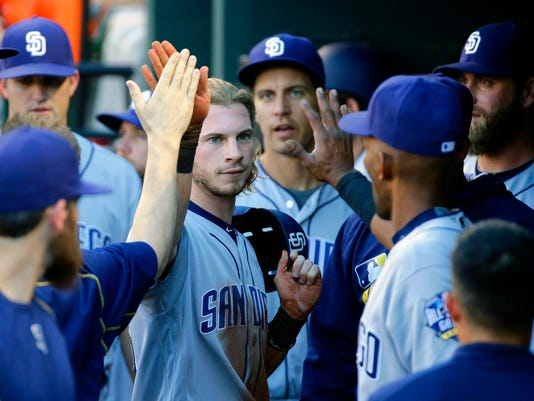 San Diego Padres' Travis Jankowski high-fives teammates in the dugout after scoring on a Matt Kemp single in the first inning of an interleague baseball game against the Baltimore Orioles in Baltimore, Wednesday, June 22, 2016. (AP Photo/Patrick Semansky)