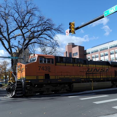 A BNSF Railway train crosses Oak Street in downtown Fort Collins. Additional BNSF trains are expected to pass through the city each for the next six weeks.