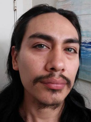 This undated photo provided by the Island County Sheriff's Office shows Jacob Gonzales, 33. Island County Sheriff Mark Brown said the body of a woman found near a gun- and ammo-filled bunker had been decapitated, and Gonzales is being sought as a suspect in the case.