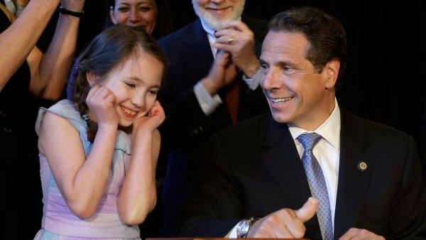 New York Governor Andrew Cuomo, right, gets some help from Amanda Houser, 10, while signing a ceremonial bill to establish a medical marijuana program in New York, Monday, July 7, 2014. New York has become the 23rd state in the U.S. to authorize medical marijuana,  though the state's program is one of the nation's most restrictive.  Cuomo signed the measure into law on Saturday and held the formal signing ceremony on Monday to highlight the new law.  When the program gets up and running in about 18 months, patients with diseases including AIDS, cancer and epilepsy will be able to obtain non-smokeable versions of the drug. Instead, the drug must be ingested or administered through a vaporizer or oil base. Houser, who has Dravet syndrome, may benefit from medical marijuana.