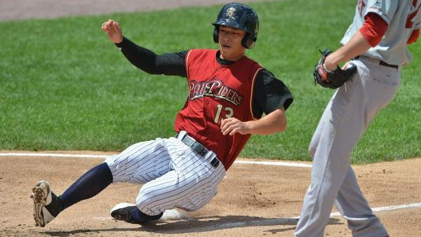 Rob Refsnyder of Scranton/Wilkes-Barre slides across home plate on a passed ball against Pawtucket on June 22. Adopted at birth out of South Korea, Refsnyder plays second base in Triple-A but was a star right fielder for 2012 national champion Arizona.