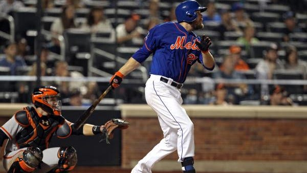 New York Mets first baseman Lucas Duda watches his solo home run in front of San Francisco Giants catcher Buster Posey (28) during the eighth inning at Citi Field.