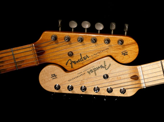 The company that owns Fender announced they are closing the U.S. plant that produces the Ovation, Guild and Fender acoustics. Take a look at the rockers who use, love and have made the company's iconic Stratocaster (which is still being produced)  famous.