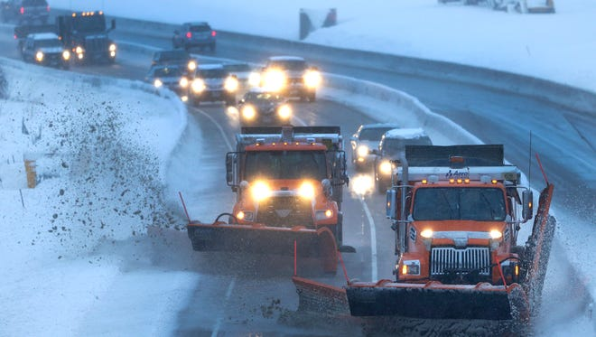 Outagamie County plows clear a path for northbound commuters along Highway 441 during a snowstorm Tuesday in Menasha, Wisconsin.