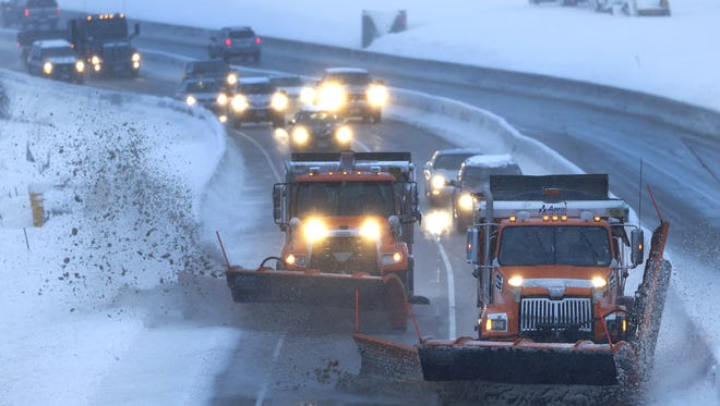 Outagamie County plows clear a path for northbound commuters along U.S. 441.