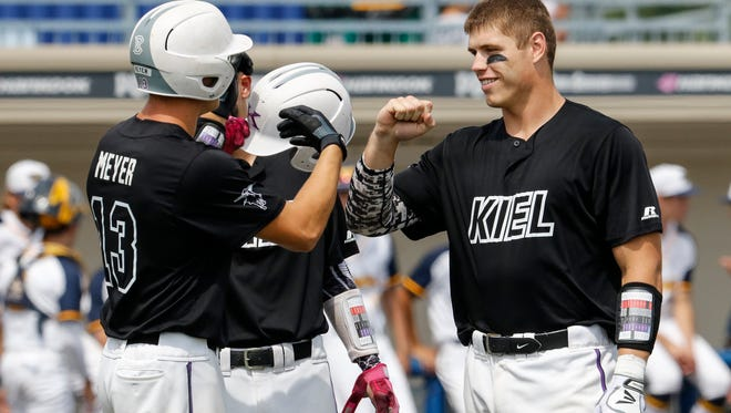 Kiel High School's Jonathan Meyer (13) fist bumps catcher Austin Goehring (11) during introductions before playing Marquette University High School in the WIAA State Summer Baseball Tournament semifinal game at Kapco Park at Concordia University Friday, Jul. 21, 2017, in Mequon, Wis. Josh Clark/USA TODAY NETWORK-Wisconsin