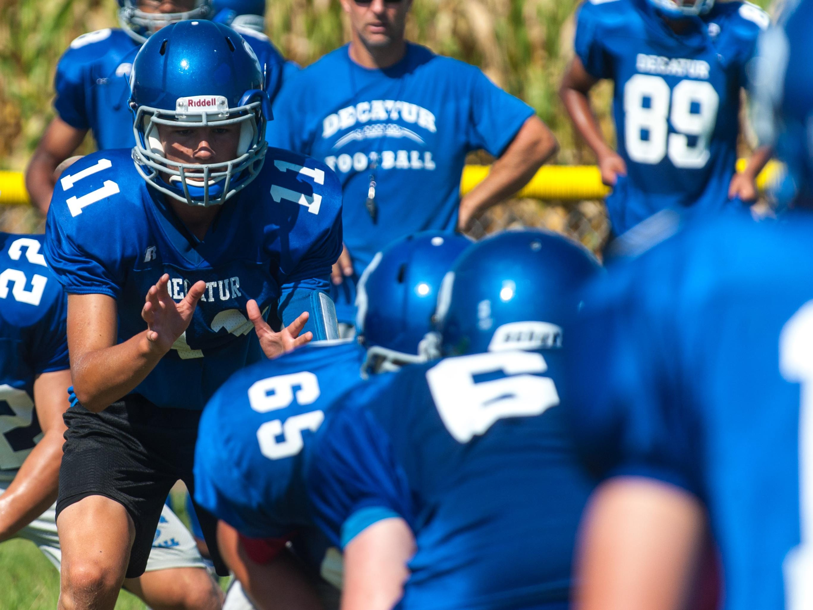Stephen Decatur players work through offensive plays during a recent practice at the school in Berlin.