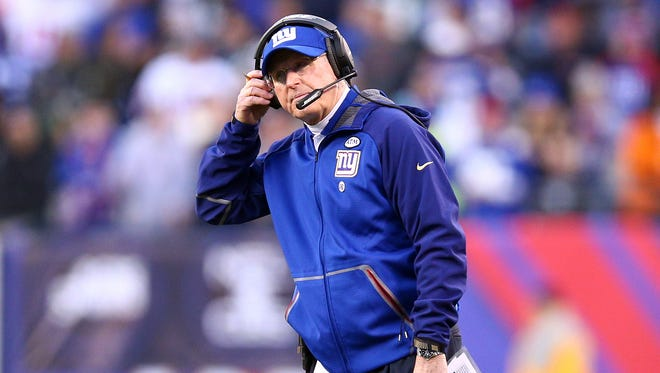 New York Giants head coach Tom Coughlin reacts during the fourth quarter against the New York Jets at MetLife Stadium.