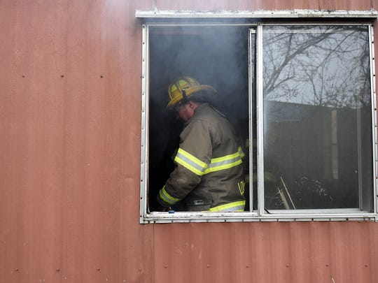 Firefighters extinguish a fire in an unoccupied mobile home in Twin Oaks Mobile Home Park on Monday. The fire, which officials say is suspicious in nature, was the third fire reported at the park in less than a month.