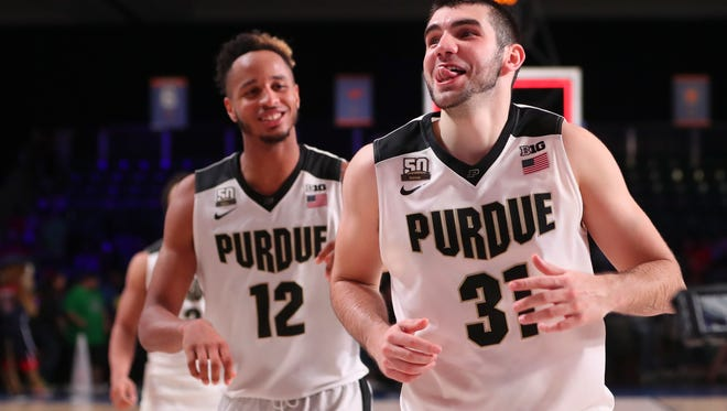 Nov 24, 2017;  Paradise Island, BAHAMAS; Purdue Boilermakers guard Dakota Mathias (31) and forward Vincent Edwards (12) react  after the victory against the Arizona Wildcats in the 2017 Battle 4 Atlantis in Imperial Arena at the Atlantis Resort. Mandatory Credit: Kevin Jairaj-USA TODAY Sports