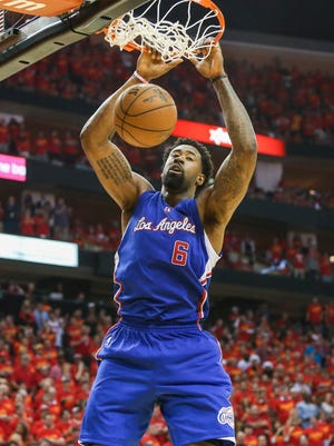 Los Angeles Clippers center DeAndre Jordan (6) dunks the ball during the fourth quarter against the Houston Rockets in game seven of the second round of the NBA Playoffs at Toyota Center. The Rockets defeated the Clippers 113-100 to win the series 4-3.