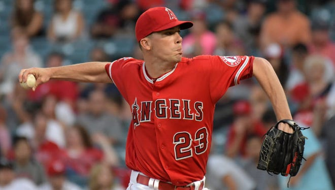 Los Angeles Angels pitcher Alex Meyer (23) delivers a pitch against the Washington Nationals during a MLB baseball game at Angel Stadium of Anaheim.