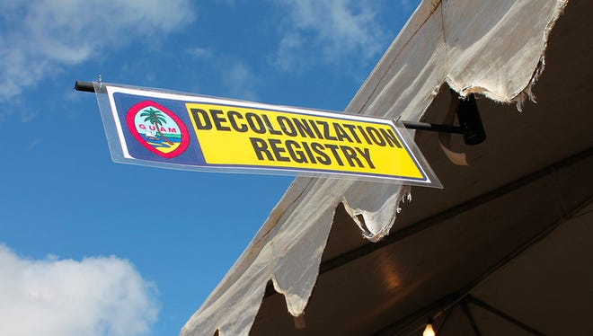 A banner promoting the decolonization registry for Guam.