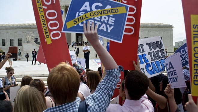 Supporters of the Affordable Care Act rally outside the Supreme Court on June 25, 2015.